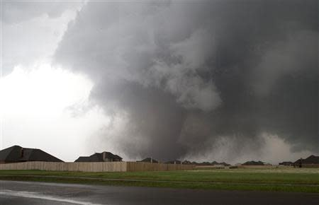 A huge tornado approaches the town of Moore, Oklahoma in this file photo