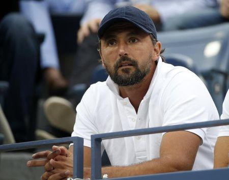 Goran Ivanisevic, coach for Marin Cilic of Croatia, watches as Cilic plays Kei Nishikori of Japan during their men's singles final match at the 2014 U.S. Open tennis tournament in New York, September 8, 2014.      REUTERS/Mike Segar