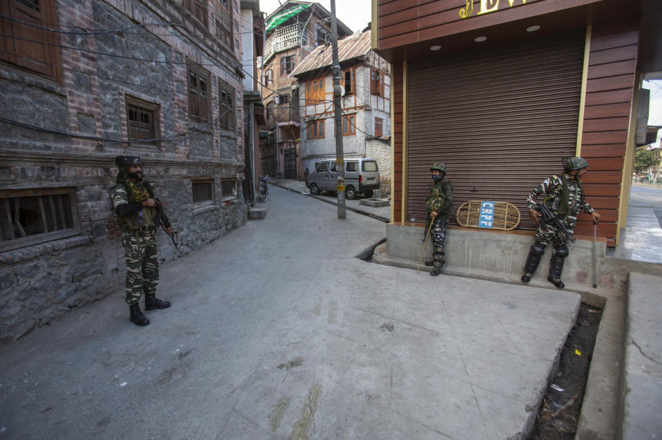 Indian paramilitary soldiers guard a deserted street in Srinagar, Indian controlled Kashmir, Sunday, Sept. 5, 2021. Authorities Sunday eased some restrictions that had been imposed after the death of top resistance leader Syed Ali Geelani. However, most shops and businesses stayed closed as government forces patrolled roads and streets in the city. (AP Photo/Mukhtar Khan)