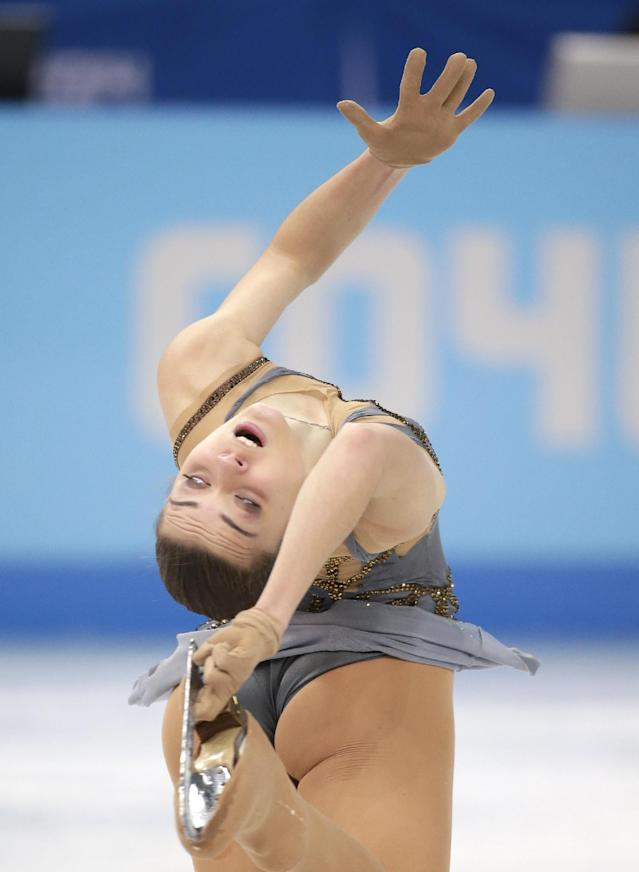 Adelina Sotnikova of Russia competes in the women's free skate figure skating finals at the Iceberg Skating Palace during the 2014 Winter Olympics, Thursday, Feb. 20, 2014, in Sochi, Russia. (AP Photo/Bernat Armangue)