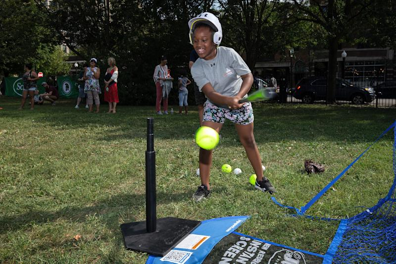Ray Elementary students hits a ball off a tee. (Photo by Dylan Buell/MLB Photos via Getty Images)