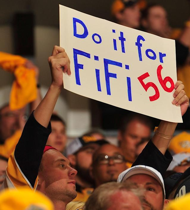<p>A fan of the Nashville Predators player Kevin Fiala holds up a sign during the first period in Game Three of the Western Conference Second Round against the St. Louis Blues during the 2017 NHL Stanley Cup Playoffs at Bridgestone Arena on April 30, 2017 in Nashville, Tennessee. Fiala suffered a season ending injury earlier in the series. (Photo by Frederick Breedon/Getty Images) </p>