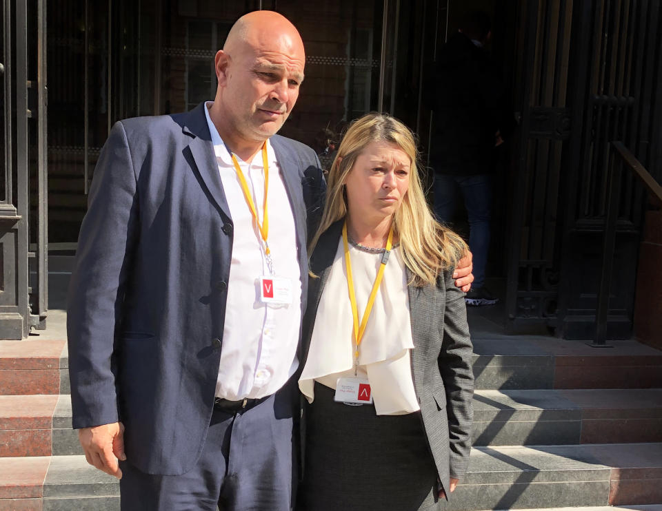 Jack's parents Nicky and Victor Adcock outside the Medical Practitioners Tribunal Service headquarters in Manchester. (PA)