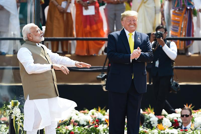 US President Donald Trump (R) and India's Prime Minister Narendra Modi greet the crowd during 'Namaste Trump' rally at Sardar Patel Stadium in Motera, on the outskirts of Ahmedabad, on February 24, 2020. (Photo by Money SHARMA / AFP) (Photo by MONEY SHARMA/AFP via Getty Images)