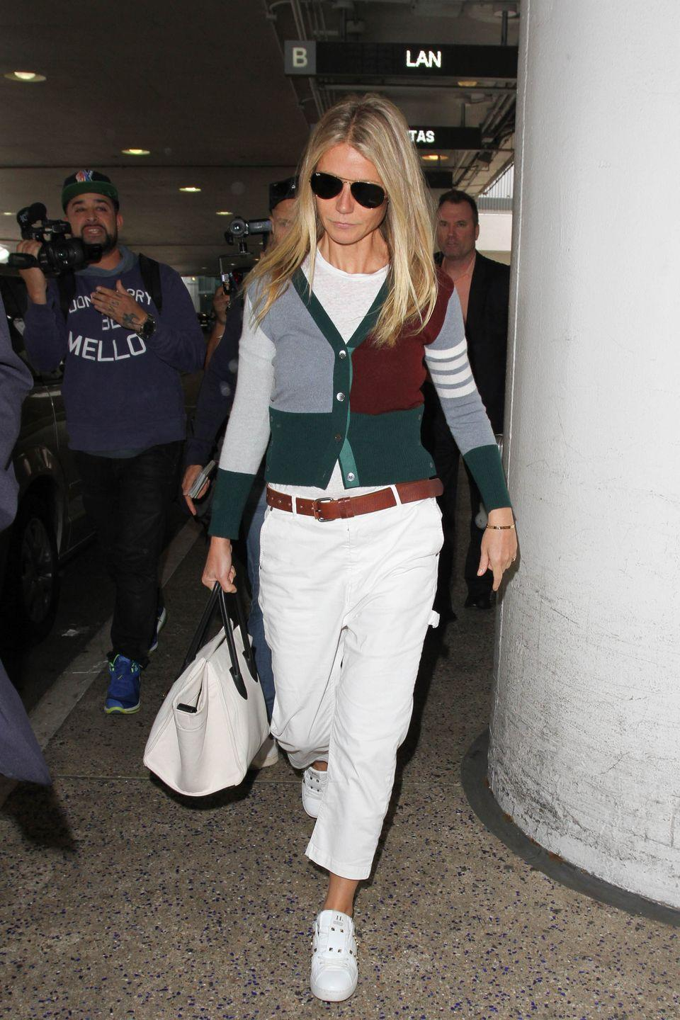 <p>Gwyneth Paltrow sported a retro sweater over a mostly white ensemble for her October trek through LAX.</p>