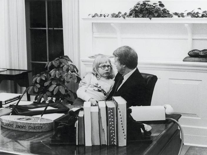 Jimmy Carter with his daughter Amy in the Oval Office, 1978.