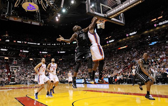 MIAMI, FL - FEBRUARY 23: Amare Stoudemire #1 of the New York Knicks has a shot blocked by Joel Anthony #50 of the Miami Heat during a game at American Airlines Arena on February 23, 2012 in Miami, Florida. NOTE TO USER: User expressly acknowledges and agrees that, by downloading and/or using this Photograph, User is consenting to the terms and conditions of the Getty Images License Agreement. (Photo by Mike Ehrmann/Getty Images)