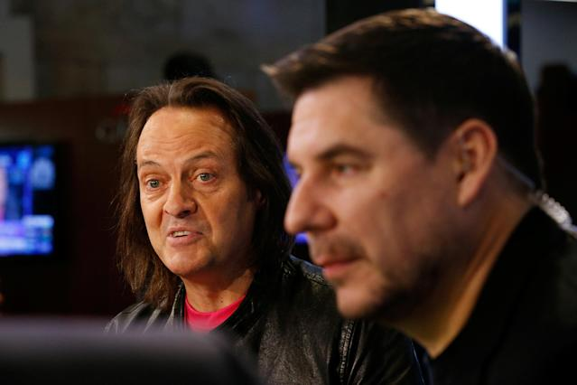 T-Mobile CEO John Legere (L) speaks as Sprint CEO Marcelo Claure looks on at the New York Stock Exchange in New York, NY, U.S., April 30, 2018. REUTERS/Brendan Mcdermid