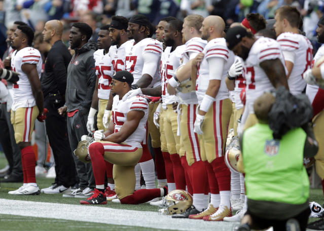 <p>San Francisco 49ers strong safety Eric Reid kneels during the singing of the national anthem before an NFL football game against the Seattle Seahawks, Sept. 17, 2017, in Seattle. (AP Photo/John Froschauer) </p>