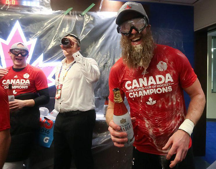 Joe Thornton of Team Canada celebrates in the locker room (Photo by Andre Ringuette/Getty Images)