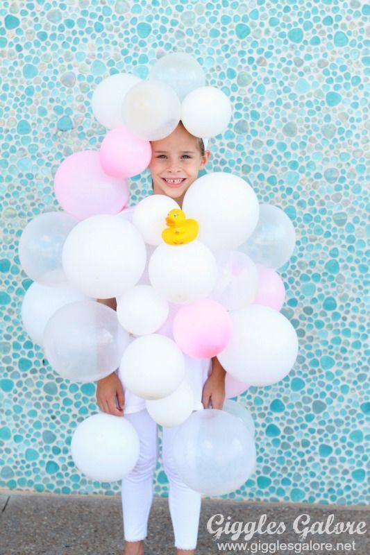 """<p>The most time-consuming part of assembling this DIY? Blowing up the balloons—take breathing breaks! </p><p><strong>Get the tutorial at <a href=""""https://gigglesgalore.net/diy-bubble-bath-halloween-costume"""" rel=""""nofollow noopener"""" target=""""_blank"""" data-ylk=""""slk:Giggles Galore"""" class=""""link rapid-noclick-resp"""">Giggles Galore</a>. </strong></p><p><strong><a class=""""link rapid-noclick-resp"""" href=""""https://www.amazon.com/Munchkin-White-Safety-Bath-Ducky/dp/B000GUZC2A/?tag=syn-yahoo-20&ascsubtag=%5Bartid%7C10050.g.23785711%5Bsrc%7Cyahoo-us"""" rel=""""nofollow noopener"""" target=""""_blank"""" data-ylk=""""slk:SHOP RUBBER DUCK"""">SHOP RUBBER DUCK</a><br></strong></p>"""