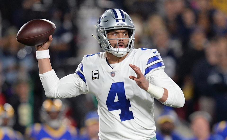 Jan 12, 2019; Los Angeles, CA, USA; Dallas Cowboys quarterback Dak Prescott (4) passes against the Los Angeles Rams in the first half in a NFC Divisional playoff football game at Los Angeles Memorial Stadium. Mandatory Credit: Gary A. Vasquez-USA TODAY Sports