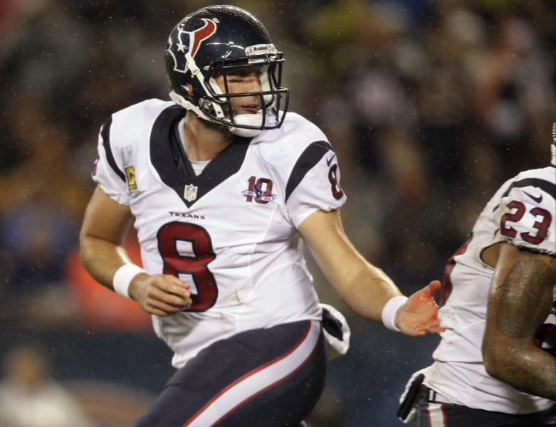 Houston Texans quarterback Matt Schaub (8) hands off to running back Arian Foster (23) during the first half an NFL football game against the Chicago Bears, Sunday, Nov. 11, 2012, in Chicago. (AP Photo/Nam Y. Huh)