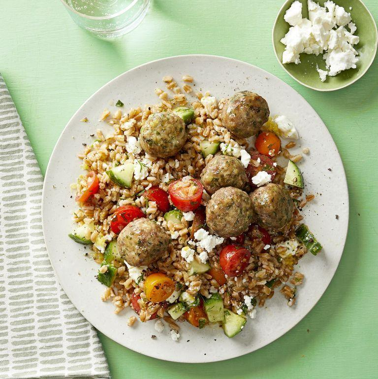 """<p>The secret to this healthy, family-friendly meal is big flavors. and a short cooking time. You can even make double the meatball recipe and freeze it for fast leftovers another day. <br></p><p><em><a href=""""https://www.womansday.com/food-recipes/a31980013/herbed-pork-meatball-and-farro-salad-recipe/"""" rel=""""nofollow noopener"""" target=""""_blank"""" data-ylk=""""slk:Get the Herbed Pork Meatball and Farro Salad recipe."""" class=""""link rapid-noclick-resp"""">Get the Herbed Pork Meatball and Farro Salad recipe.</a></em></p>"""