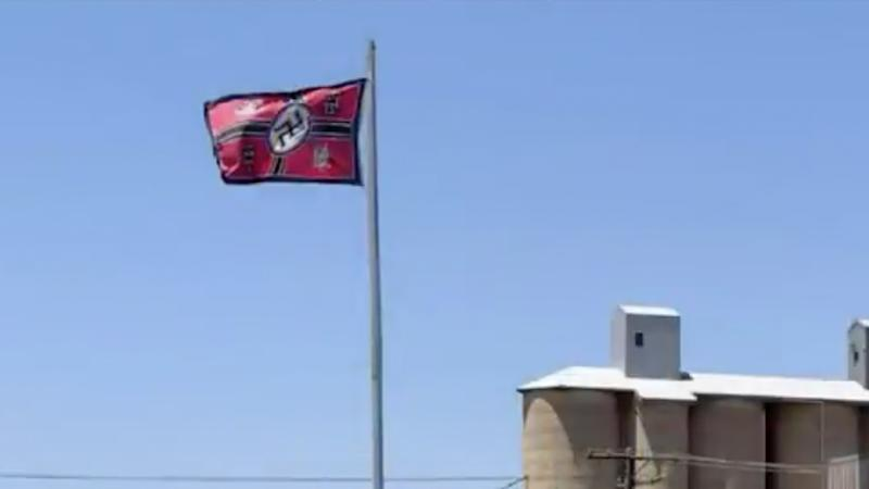 A swastika flag flying on a property at Beulah, Victoria. Source: Today