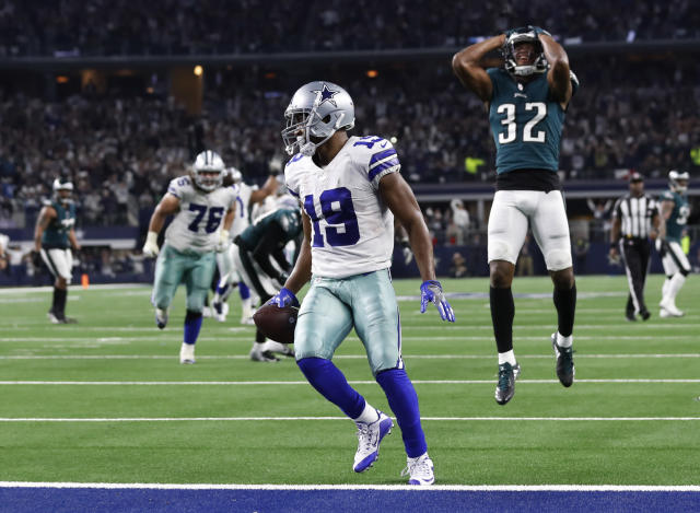 Dallas Cowboys wide receiver Amari Cooper (19) scores a 15-yard touchdown in overtime against the Eagles. (AP)