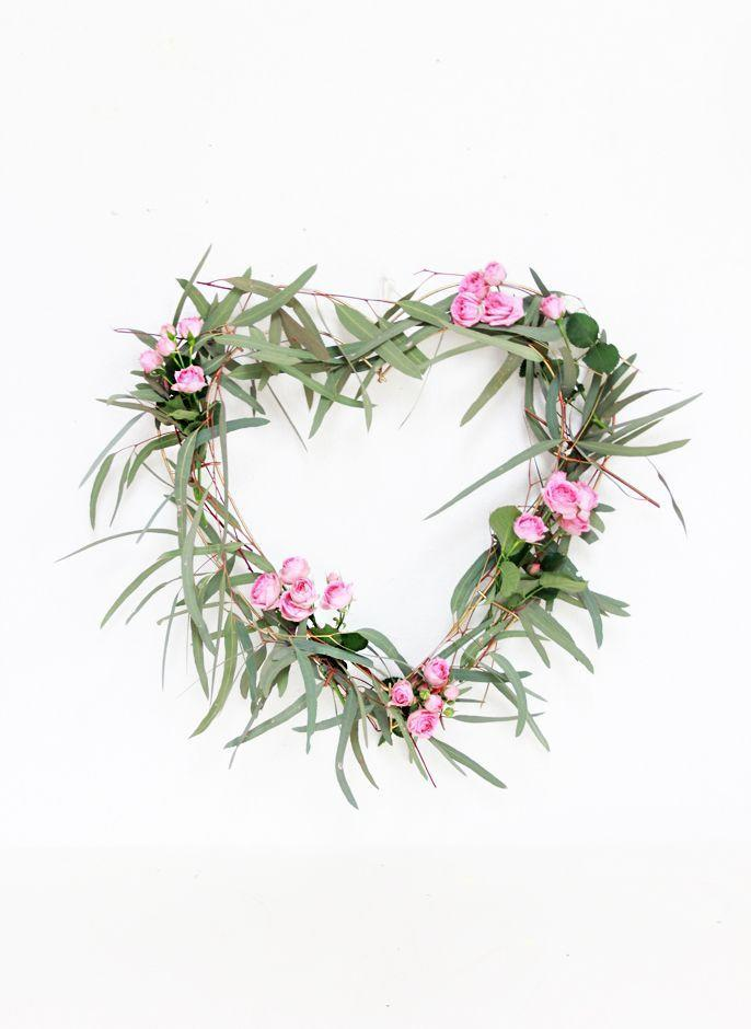 """<p>Go green this Valentine's day with a wreath made of clippings from your backyard, in this case fragrant eucalyptus delicately dotted with mini roses.</p><p><strong>Get the tutorial at <a href=""""https://abubblylife.com/2016/01/diy-heart-eucalyptus-wrea.html/"""" rel=""""nofollow noopener"""" target=""""_blank"""" data-ylk=""""slk:A Bubbly Life"""" class=""""link rapid-noclick-resp"""">A Bubbly Life</a>.</strong></p><p><a class=""""link rapid-noclick-resp"""" href=""""https://www.amazon.com/s?k=Floral+Tapes&rh=n%3A8090856011&ref=nb_sb_noss&tag=syn-yahoo-20&ascsubtag=%5Bartid%7C10050.g.35057743%5Bsrc%7Cyahoo-us"""" rel=""""nofollow noopener"""" target=""""_blank"""" data-ylk=""""slk:SHOP FLORAL TAPE"""">SHOP FLORAL TAPE</a><br></p>"""