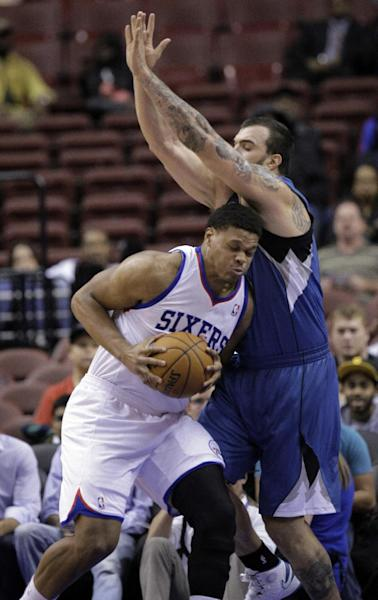 Philadelphia 76ers' Daniel Orton, left, is fouled by Minnesota Timberwolves' Nikola Pekovic in the first half of a preseason NBA basketball game, Wednesday, Oct. 23, 2013, in Philadelphia. (AP Photo/Laurence Kesterson)
