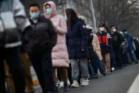 People line up to get their nucleic acid test at a mass testing site following the outbreak of the coronavirus disease (COVID-19) in Beijing