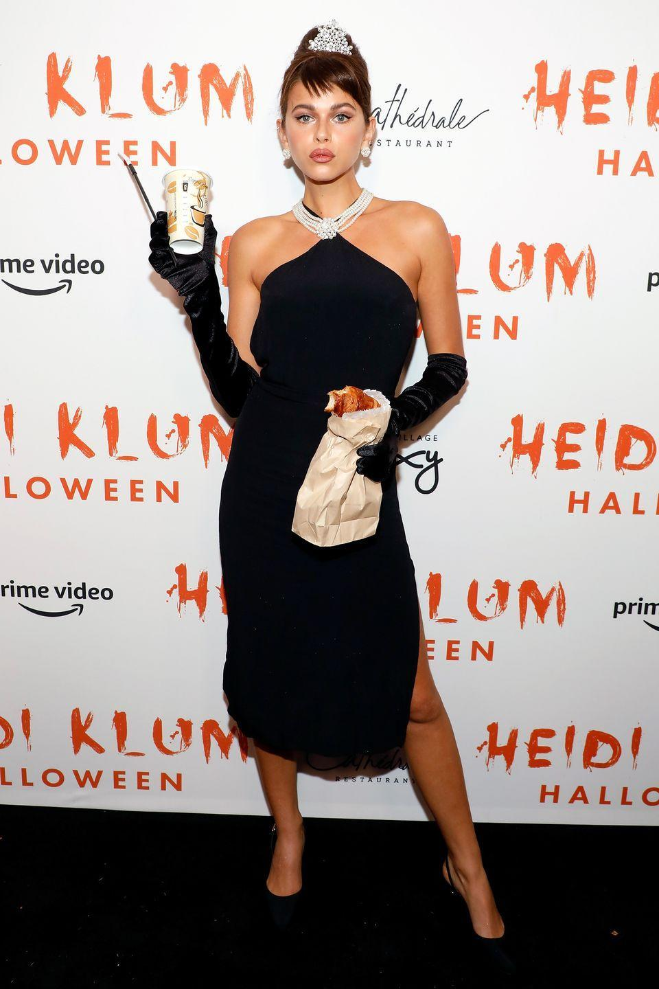 <p>The model went full Breakfast at Tiffany's Audrey Hepburn, even accessorising with a coffee and croissant, for Klum's A-List filled party.</p>