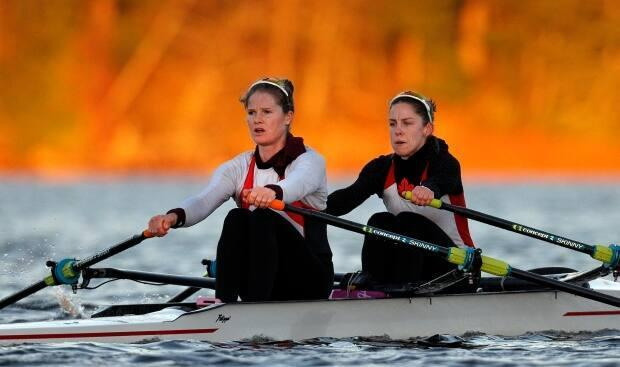 Jennifer Casson, left, trains with partner Jill Moffatt, right, on Elk Lake in Victoria. The duo could be headed to Tokyo after Canada was awarded an Olympic spot on Friday. (Kevin Light Photography - image credit)
