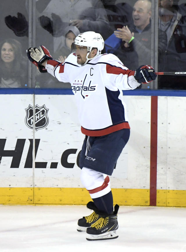 Washington Capitals' Alex Ovechkin looks to the referee for a call after New York Rangers goaltender Alexandar Georgiev threw his stick as Ovechkin skated in during a shootout in an NHL hockey game Sunday, March 3, 2019, at Madison Square Garden in New York. The referees awarded Ovechkin the goal. (AP Photo/ Bill Kostroun)