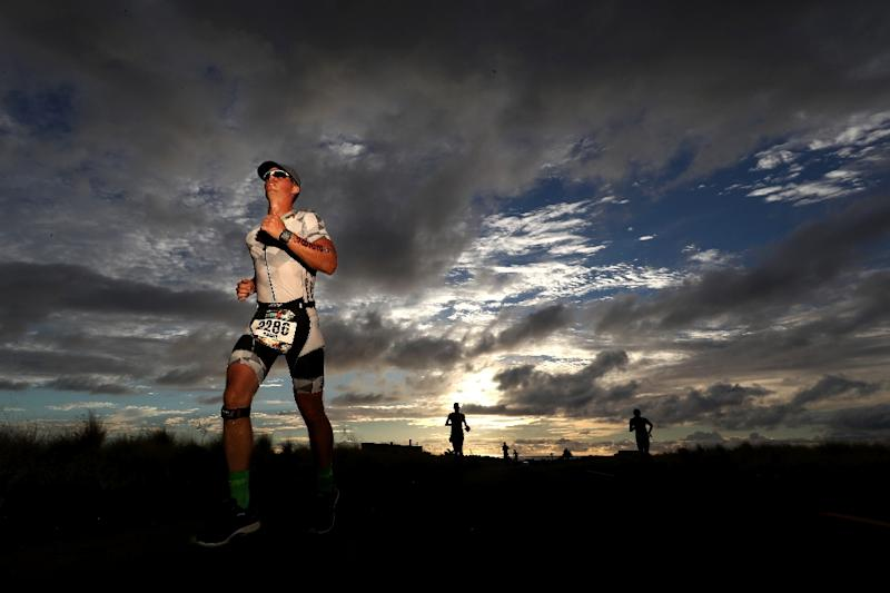 Triathletes nearing the end of the legendary Ironman race in Hawaii, in October 2018 (AFP Photo/AL BELLO)