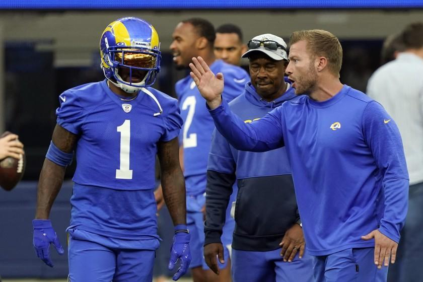 Los Angeles Rams coach Sean McVay, right, talks to wide receiver DeSean Jackson during the NFL football team's camp Thursday, June 10, 2021, in Inglewood, Calif. (AP Photo/Marcio Jose Sanchez)