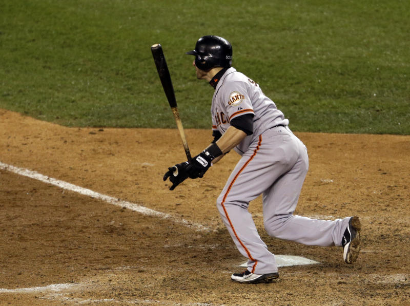 San Francisco Giants' Marco Scutaro hits RBI single during the 10th inning of Game 4 of baseball's World Series against the Detroit Tigers Sunday, Oct. 28, 2012, in Detroit. Ryan Theriot scored on the hit. (AP Photo/Patrick Semansky)