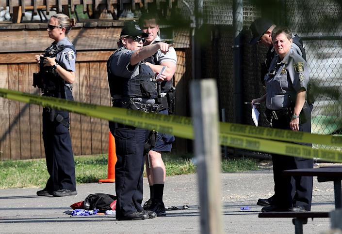 <p>Investigators gather at Eugene Simpson Field, the site where a gunman opened fire June 14, 2017 in Alexandria, Va. (Photo: Win McNamee/Getty Images) </p>
