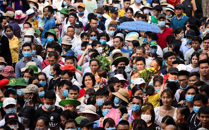 People attend a festival at Hung Kings temple in a first massive gathering after coronavirus disease restrictions were lifted in Vietnam - Thanh Hue/Reuters