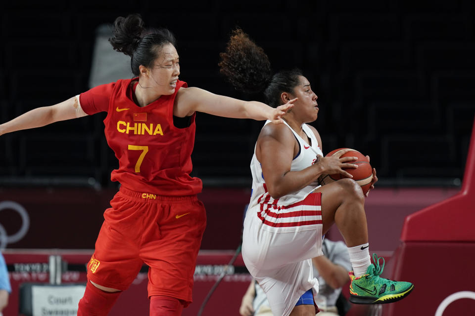 Puerto Rico's Jennifer O'Neill (0) pulls down a rebound from China's Ting Shao (7) during a women's basketball preliminary round game at the 2020 Summer Olympics in Saitama, Japan, Tuesday, July 27, 2021. (AP Photo/Eric Gay)