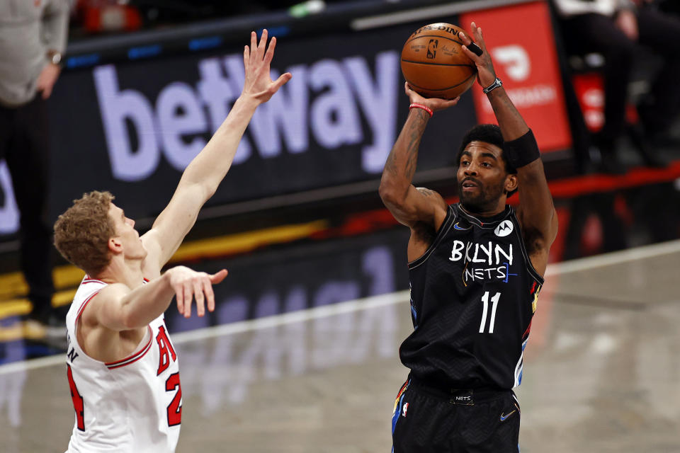 Brooklyn Nets guard Kyrie Irving (11) shoots over Chicago Bulls forward Lauri Markkanen during the second half of an NBA basketball game Saturday, May 15, 2021, in New York. (AP Photo/Adam Hunger)