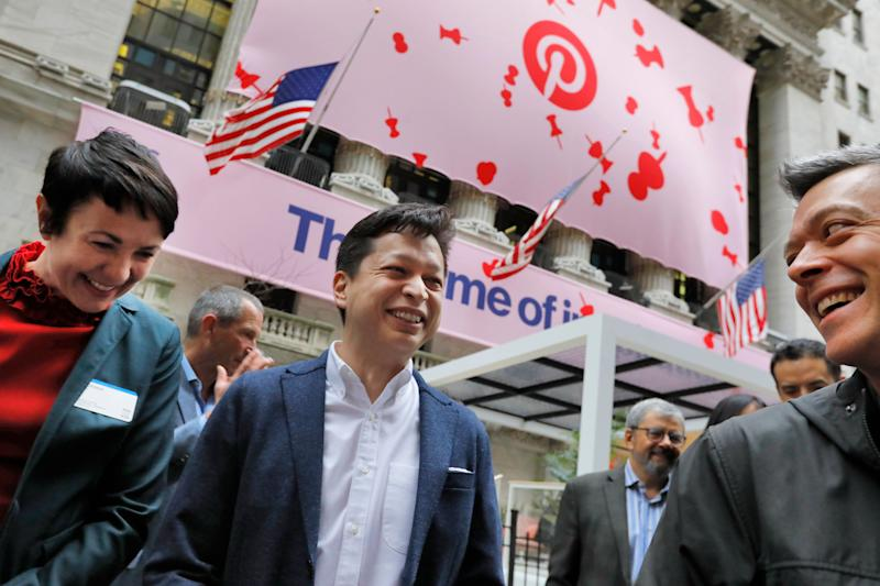 Pinterest co-founder & CEO Ben Silbermann, center, gathers with company employees outside the New York Stock Exchange, Thursday, April 18, 2019, before the Pinterest IPO. (AP Photo/Richard Drew)