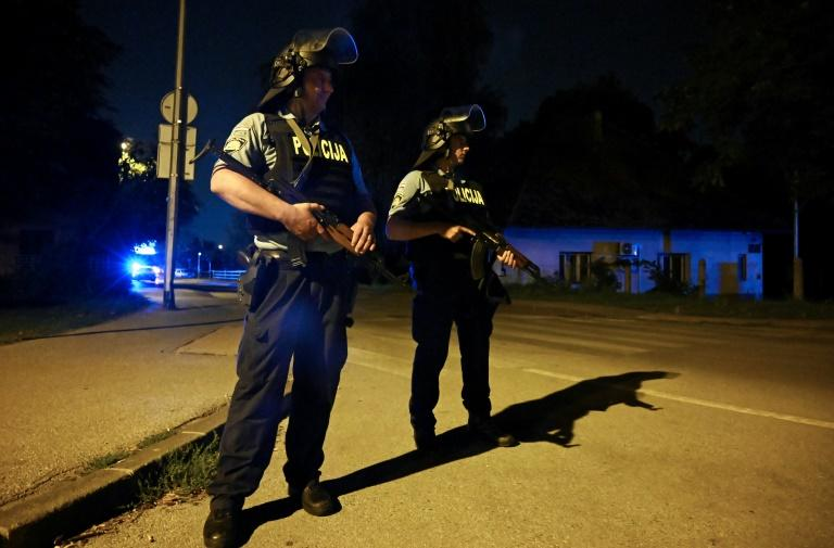 Officers stand guard in a southern neighborhood of Zagreb, Croatia where six bodies were found shot dead in a house (AFP Photo/Denis LOVROVIC)