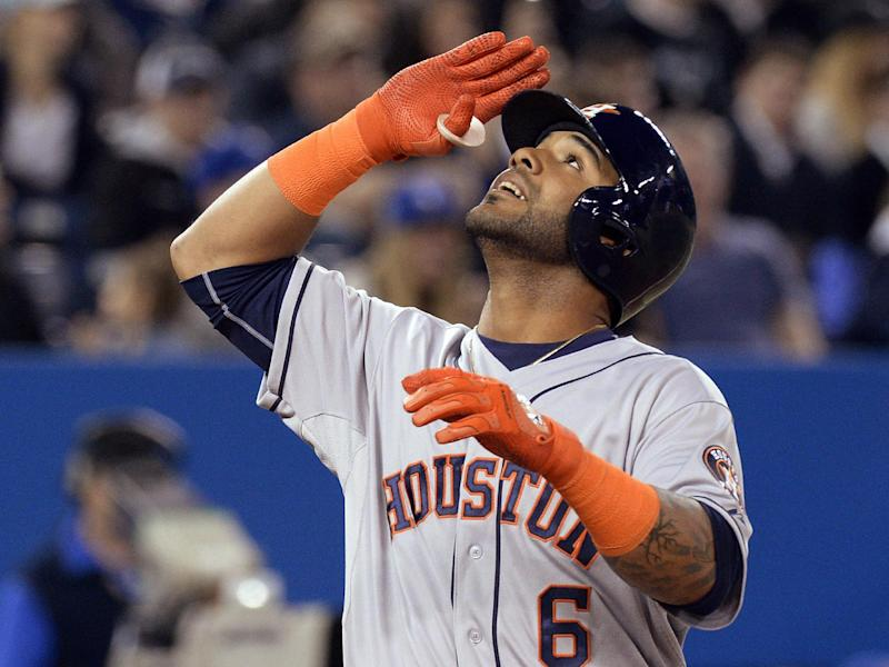 Houston Astros' Jonathan Villar salutes after hitting a three-run home run off Toronto Blue Jays starting pitcher R.A. Dickey during the seventh inning of baseball game in Toronto on Thursday, April 10, 2014. (AP Photo/The Canadian Press, Frank Gunn)