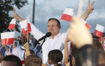 Polish President Andrzej Duda speaks to supporters at a presidential election campaign rally in Lomza, Poland, on Tuesday July 7, 2020. Two bitter rivals are heading into a razor's-edge presidential runoff election Sunday in Poland that is seen as an important test of populism in Europe after a campaign that exacerbated a conservative-liberal divide in the country. (AP Photo/Czarek Sokolowski)