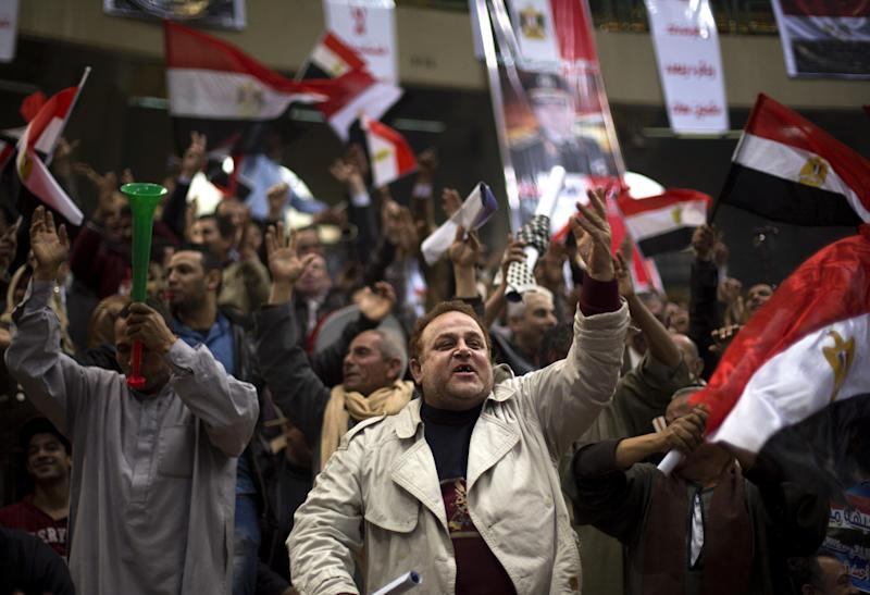 Egyptians chant slogans as they attend a rally in support of Egypt's Defense Minister, Gen. Abdel-Fattah el-Sissi, in Cairo, Egypt, Tuesday, Jan. 21, 2014. Supporters of the powerful army chief and defense minister urged Egyptians on Tuesday to turn the third anniversary to 2011 uprising that toppled longtime autocratic president Hosni Mubarak, to a show of gratitude to the general for ousting Islamist president, calling on him to contest elections. (AP Photo/Khalil Hamra)