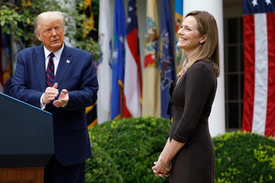 Judge Amy Coney Barrett reacts as President Donald Trump introduces her as his Supreme Court nominee in September at the Rose Garden,