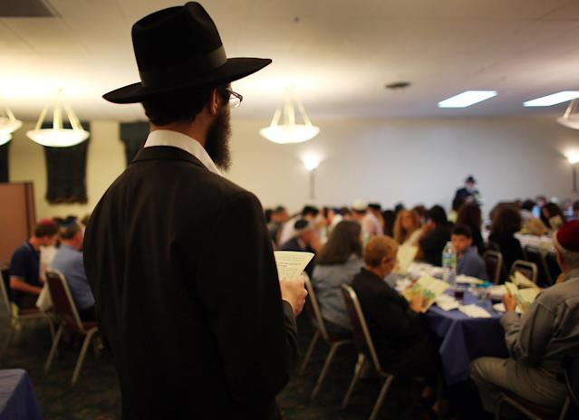 MIAMI BEACH, FL - MARCH 25: People take part in a community Passover Seder at Beth Israel synagogue on March 25, 2013 in Miami Beach, Florida. The community Passover Seder that served around 150 people has been held for the past 30 years and is welcome to anyone in the community that wants to commemorate the emancipation of the Israelites from slavery in ancient Egypt. (Photo by Joe Raedle/Getty Images)