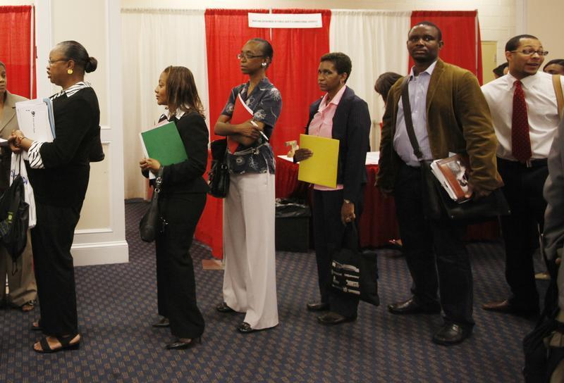Attendees line up for a job interview at a job fair in Washington