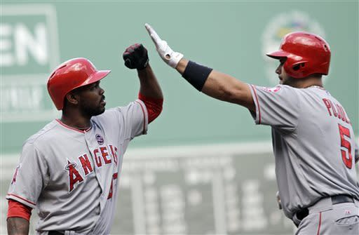 Los Angeles Angels designated hitter Albert Pujols (5) is congratulated by on deck batter Howie Kendrick (47) after hitting a home run during the first inning of a baseball game against the Boston Red Sox, Sunday, June 9, 2013 at Fenway Park in Boston. (AP Photo/Mary Schwalm)