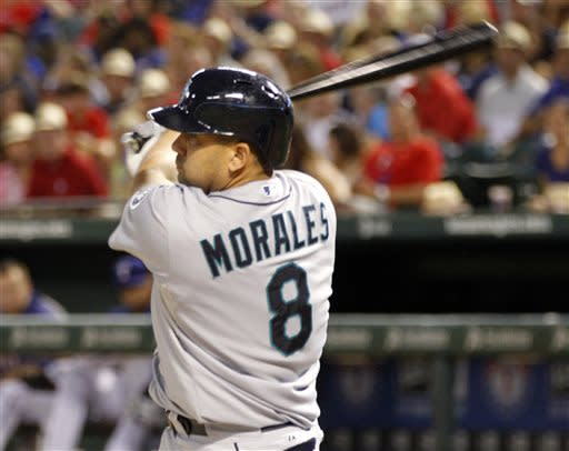 Seattle Mariners designated hitter Kendrys Morales follows through on a two-run single during the sixth inning of a baseball game Tuesday, July 2, 2013, in Arlington, Texas. (AP Photo/John F. Rhodes)