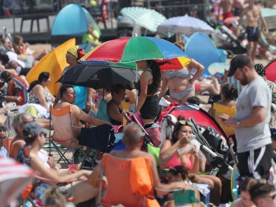 People enjoy the hot weather at Southend beach in Essex (PA)