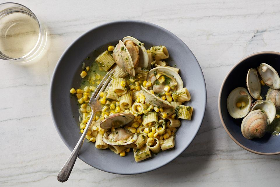 """Garlicky littleneck or Manila clams steam open in white wine, then turn into a silky sauce with a bit of pasta water, fresh corn, and homemade or storebought pesto. <a href=""""https://www.epicurious.com/recipes/food/views/pasta-with-clams-corn-and-basil-pesto?mbid=synd_yahoo_rss"""" rel=""""nofollow noopener"""" target=""""_blank"""" data-ylk=""""slk:See recipe."""" class=""""link rapid-noclick-resp"""">See recipe.</a>"""