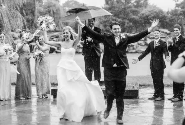 """""""What do you do when a&nbsp;sudden downpour happens in the middle of your ceremony? You own it! It was stunning and SO memorable! """" --&nbsp;<i>Sarah Libby</i>"""