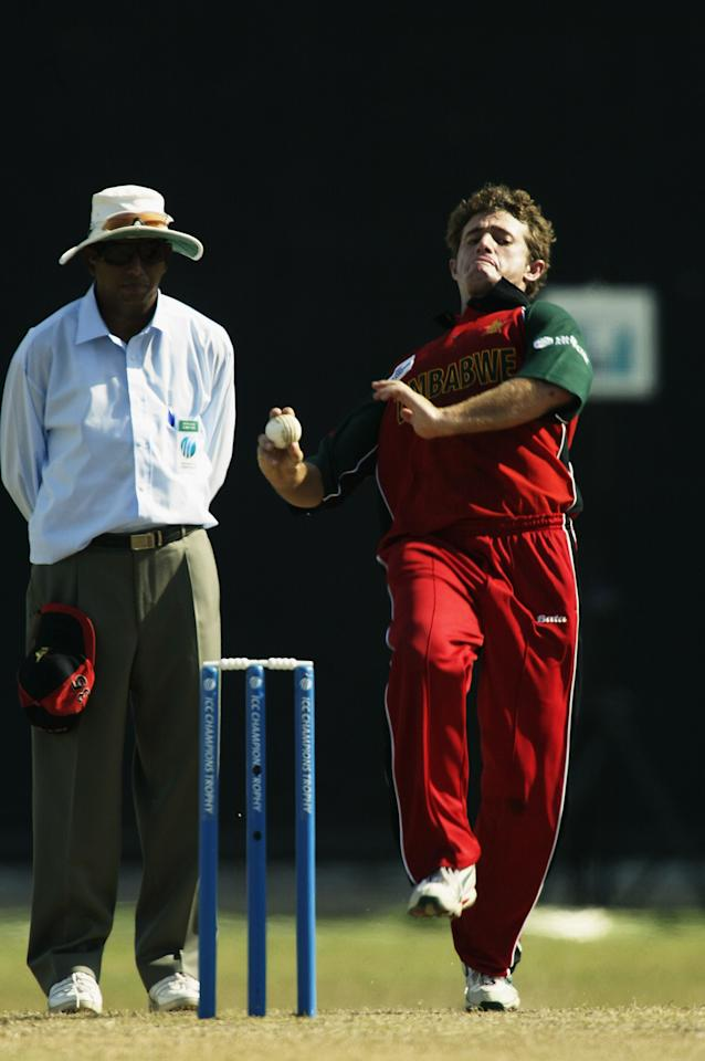 COLOMBO - SEPTEMBER 14:  Guy Whittall of Zimbabwe in action during the ICC Champions Trophy match between India and Zimbabwe held on September 14, 2002 at the R. Premadasa Stadium, in Colombo, Sri Lanka. (Photo by Clive Mason/Getty Images)