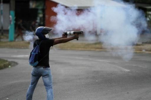 Students in the capital Managua clash with riot police during a protest against the government's social security reforms on April 20, 2018