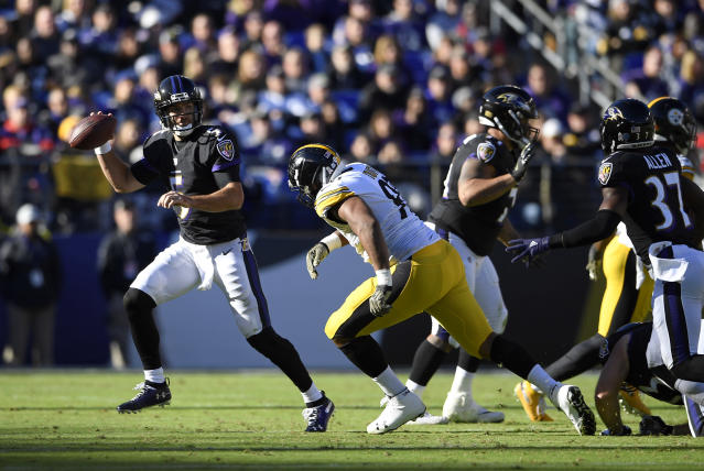The Steelers' Stephon Tuitt chases Baltimore's Joe Flacco last Sunday. A Tuitt takedown reportedly led to a hip injury for Flacco. (AP)