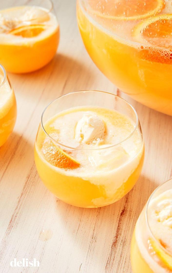 "<p>Orange + Ice Cream + Booze = Creamsicle Party In A Glass!</p><p>Get the recipe from <a href=""https://www.delish.com/cooking/recipe-ideas/recipes/a52743/creamsicle-punch-recipe/"" rel=""nofollow noopener"" target=""_blank"" data-ylk=""slk:Delish"" class=""link rapid-noclick-resp"">Delish</a>.<br></p>"